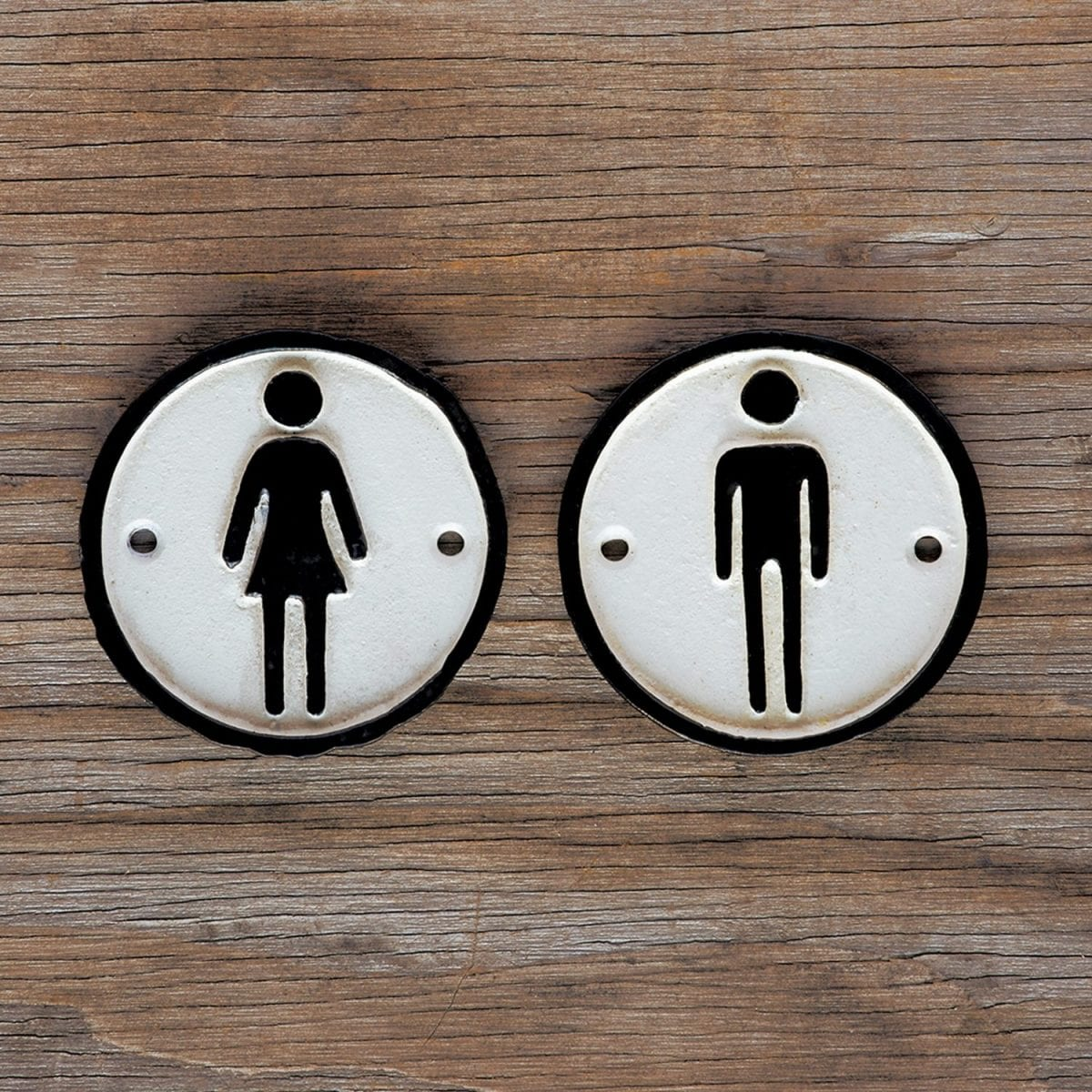man_and_woman_cast_iron_signs