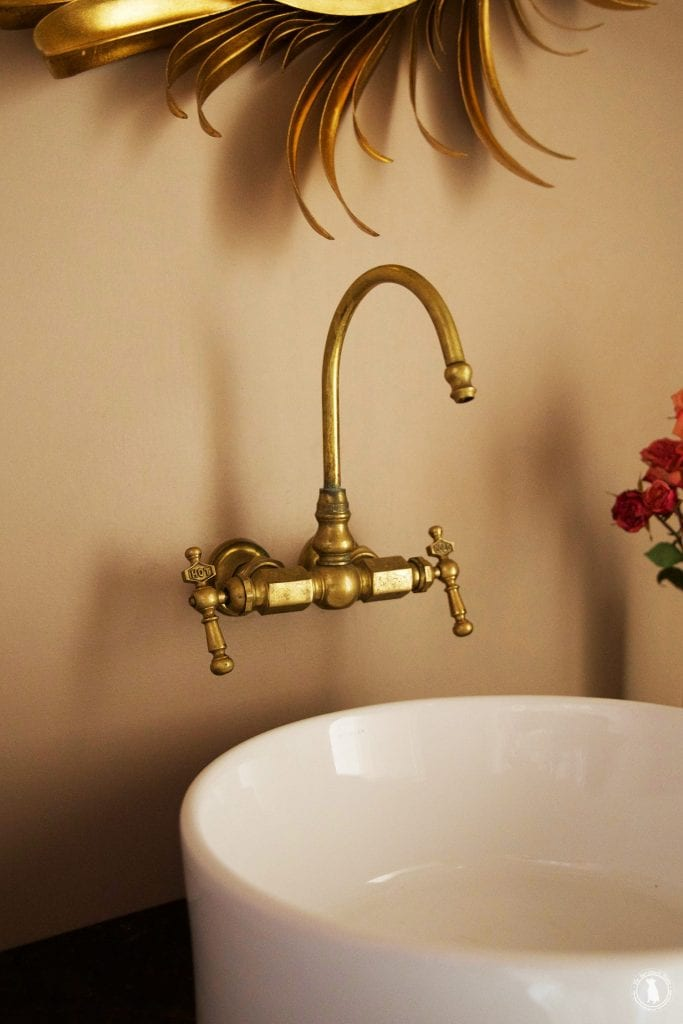Fancy With brass accents a pretty little top mount porcelain sink and soapstone but of course it us all in the details